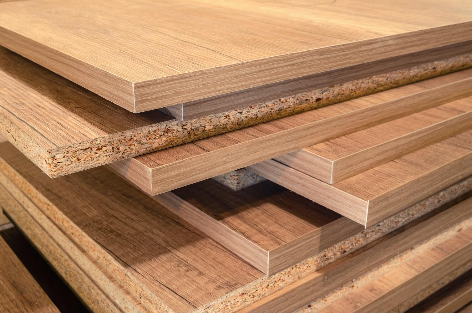 an image with various types of wood including MDF, particle board, and plywood